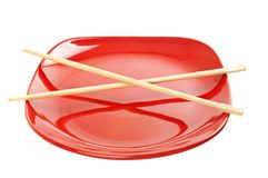 Red plate with chinese sticks Stock Images