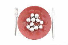 Red plate with Christmas silver ball Stock Photos