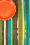 Red plate on the cloth. Stock Photos