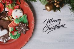 Red plate with colorful christmas cookies royalty free stock photography