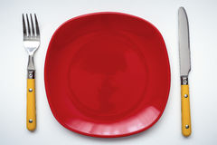 Red plate and cutlery Royalty Free Stock Image