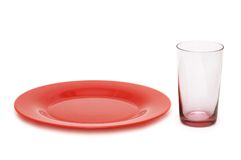 Red plate and glass isolated Royalty Free Stock Photo