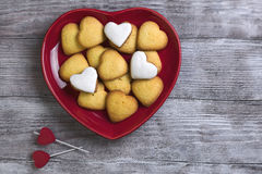 Red plate with heart shaped cookies Royalty Free Stock Photo