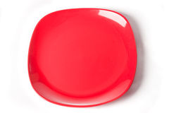 Red plate isolated on white background Stock Images