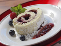 Red plate rolled cake Stock Photography