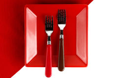Red plate and two forks Stock Photo