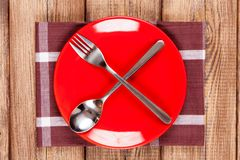 Red plate on a wooden table Stock Photography