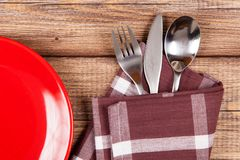 Red plate on a wooden table Royalty Free Stock Photo