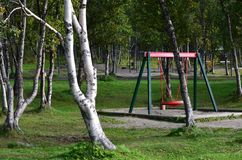 Red playground swing set Royalty Free Stock Images
