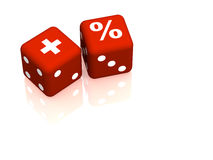 Red playing bones with symbols plus and percent Royalty Free Stock Photography