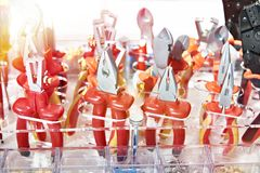 Pliers in store. Red pliers in hardware store royalty free stock image