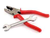 Red pliers and spanner Royalty Free Stock Image