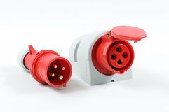 Red plug and socket. Closeup of red high voltage plug and socket isolated on a white background royalty free stock photography