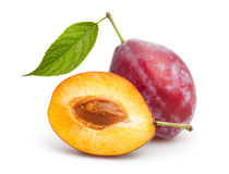 Red plum. Cut on white background Stock Photos