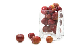 Red plum fruit in glass box Royalty Free Stock Photography