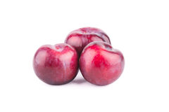Red plum fruit isolated on white. Background Royalty Free Stock Photography