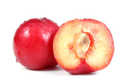 Red plum and a half of a plum Royalty Free Stock Images