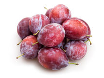 Red plum. Heap on white background Royalty Free Stock Image