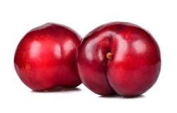 Red plum isolated on the white background Stock Image