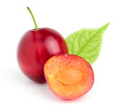 Red plum with a leaf. Royalty Free Stock Images