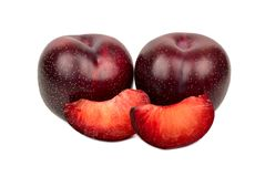 Red plum with slice. Fresh red plums with two slices on a white background Stock Photography