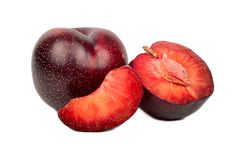 Red plum with slice. Ripe red plum with half and slice on white background Stock Images