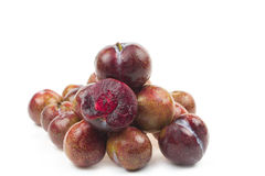 Red plum with slice. On  white background Royalty Free Stock Photos