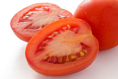 Red plum tomato cut in half Stock Photos