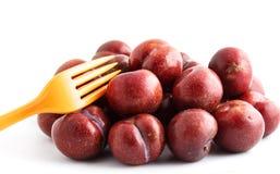 Red plum on white background Stock Photos