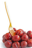 Red plum on white background Stock Image
