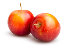 Red plum. On white background Stock Photo