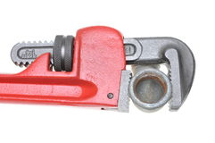 Red plumbers pipe wrench and plumbing component Stock Photography