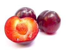 Red plums. Isolated on white background stock photography