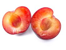 Red plums. On white background stock photo