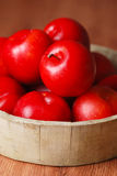 Red plums in bowl Royalty Free Stock Photography