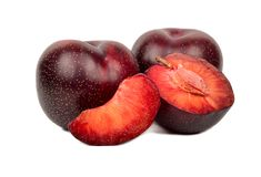 Red plum with slice. Red plums in half and slice on white background Stock Images