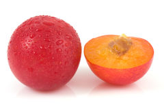Red plums on isolated Stock Images