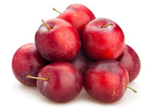 Red plums. Path  on white Stock Photos