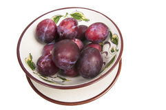 Red plums in a special fruit bowl Royalty Free Stock Images