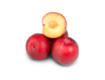 Red plums on white Royalty Free Stock Photo
