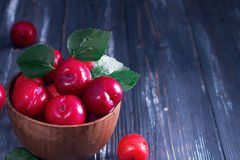 Red plums on wooden table Stock Image