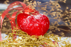 Red plush heart as a symbol of love valentine's name on a snow Stock Photography