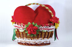 Red plush heart in the bascket Stock Photos