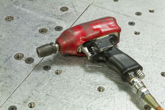 Red pneumatic wrench Stock Photos