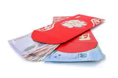 Red pocket and lucky money on chinese new year Royalty Free Stock Photos
