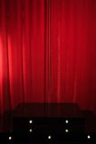 Red podium on a background of red drape curtains Stock Photos