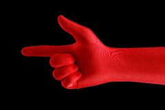 Red pointing finger. Strange gloved hand pointing with a finger Royalty Free Stock Photo