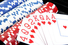 Red poker cards and different  chips Stock Images
