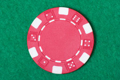 Red poker chip on the casino table Stock Photos