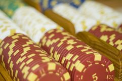 Red poker chips. Poker chips with the number 5 as the main focus of this image Stock Image